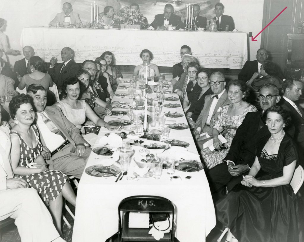 The Sisterhood of Kneseth Israel Congregation in Kittanning, PA spread its signature tablecloth across the dais at a banquet for the dedication of its new synagogue in June 1954. Image courtesy Rauh Jewish History Program & Archives.)